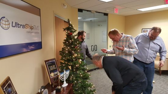 How many managers does it take to implement a Christmas tree?